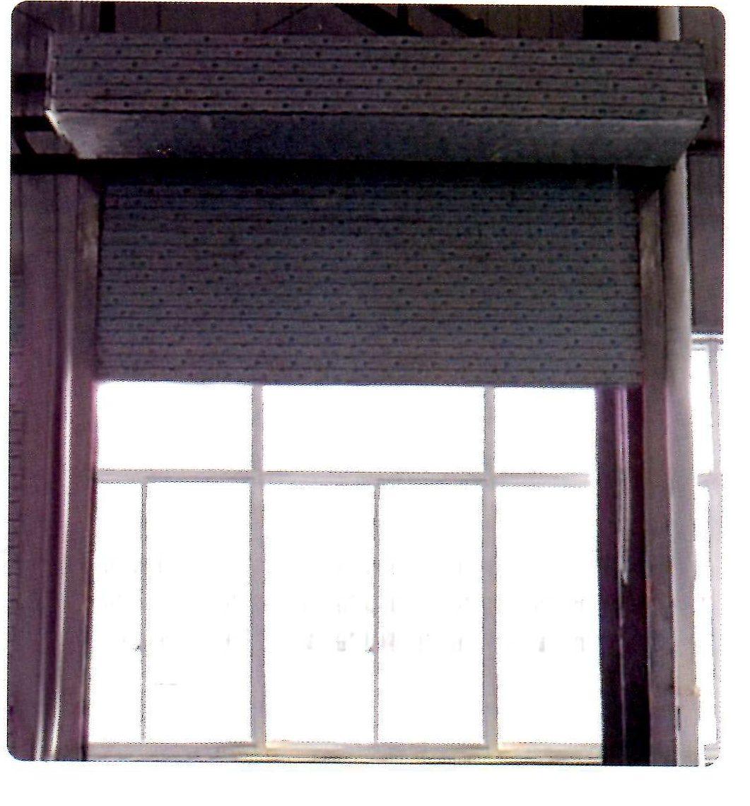 Electric weathertight roller door